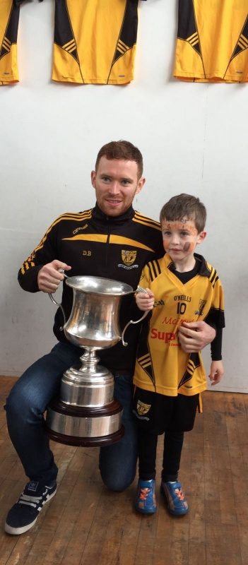 county champion James Brady and the Oliver Plunkett cup. Well done Ramor Utd!